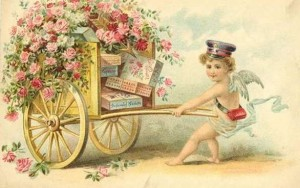 tn_vintage-victorian-valentine-card-cherub-messenger-pulling-cart-with-roses